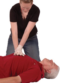 Woman performing chest compressions on a man's chest.