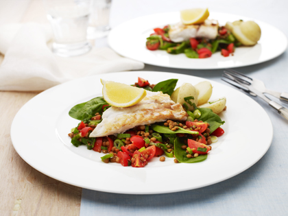 Fish with lentil spinach salad