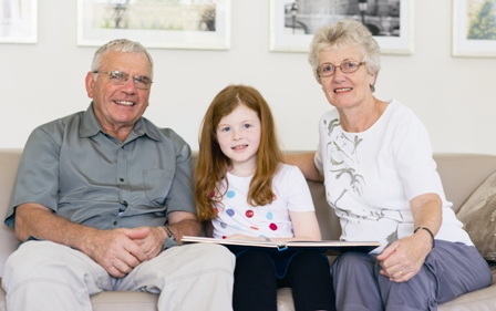 girl with grandparents
