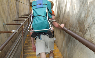 Backpacker walking up a flight of stairs